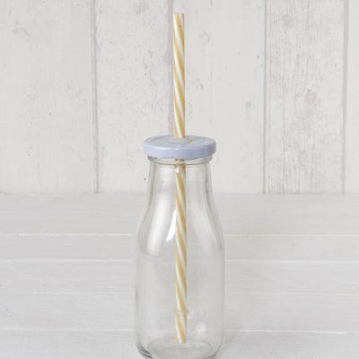 Botella de cristal con tapa y caña beige